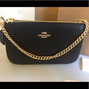 NWT Coach large wristlet in black pebbled leather